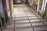 photo of underfloor heating in slab and screed floor prepared for hardwood flooring