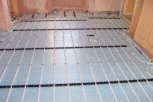 photo of underfloor heating in slab and screed floor with perimeter insulation