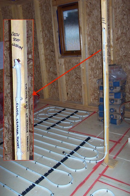 photo of underfloor heating with closup of floor sensor