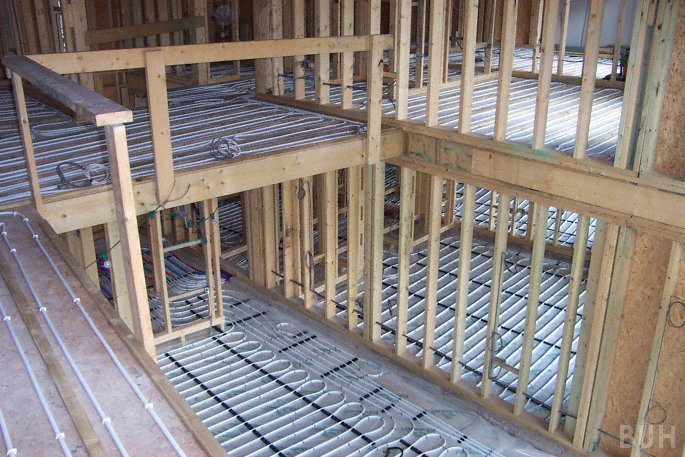 Photo of upper and ground floors with underfloor heating pipes