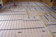 photo overview of underfloor heating in slab and screed floor