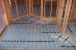 photo of underfloor heating in slab and screed floor with wall partitions
