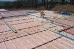 photo of underfloor heating in slab and screed floor